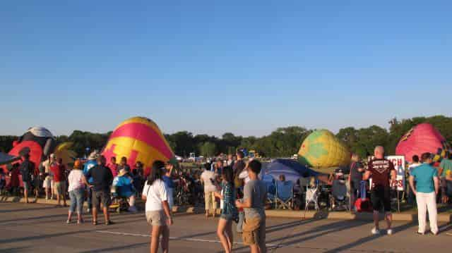 A swarm of Hot Air Balloons filling up