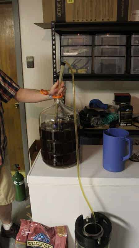 Siphoning the beeer from the carboy to the Keg