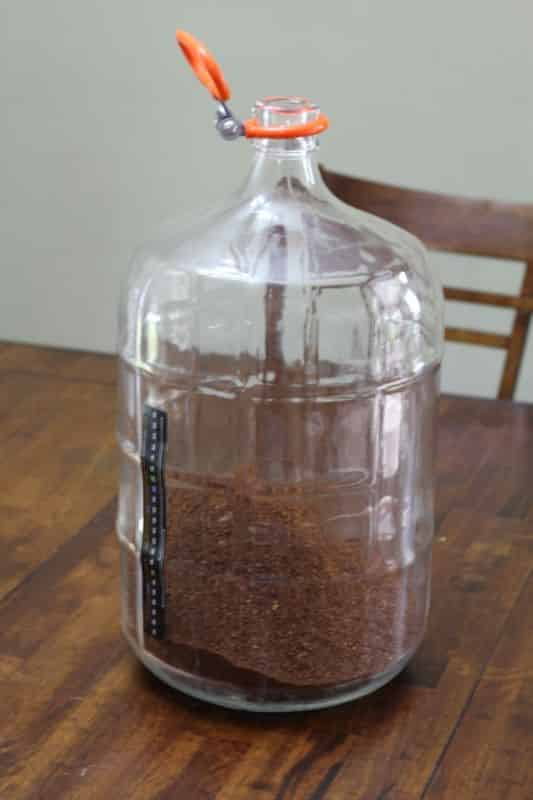 Coffee grounds poured into the carboy #1