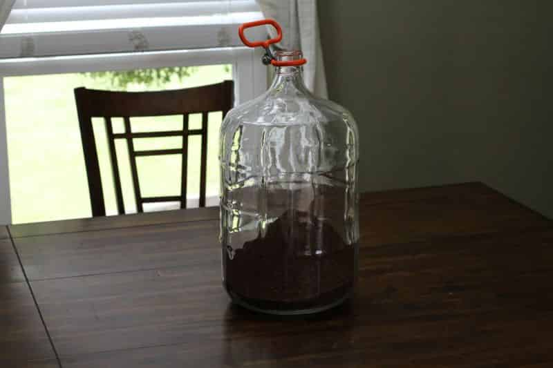 Coffee grounds poured into the carboy #2